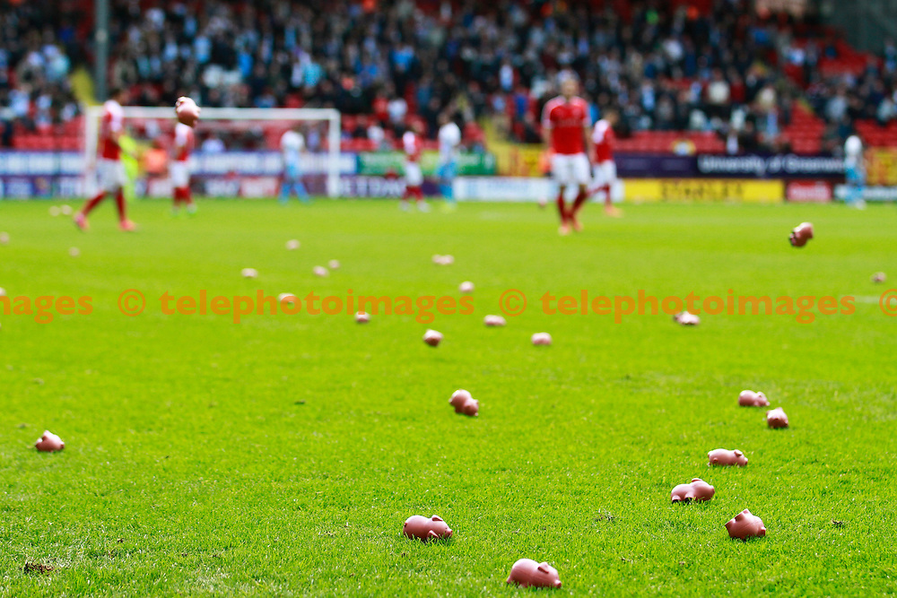 Charlton fans protest by throwing plastic pigs onto the pitch at the start of the match during the Sky Bet League 1 match between Charlton Athletic and Coventry City at The Valley in London. October 15, 2016.<br /> John Marsh / Telephoto Images<br /> +44 7967 642437