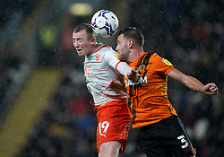 Blackpool's Shayne Lavery battles with Hull City's Callum Elder during the Sky Bet Championship match at the MKM Stadium, Hull. Picture date: Tuesday September 28, 2021.