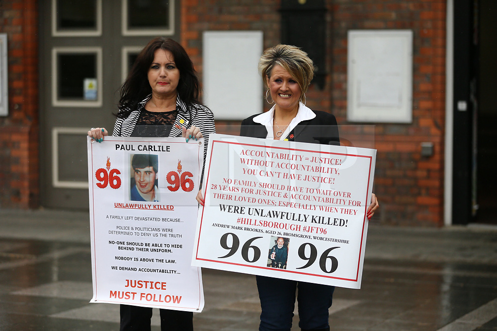© Licensed to London News Pictures. 28/06/2017. Warrington, UK. Donna Miller (left) & Louise Brookes arrive at Parr Hall. Families of the 96 people killed at the Hillsborough disaster in 1989 will today find out if criminal charges will be brought after Prosecutors examining files identified 23 criminal suspects. Families will be informed of the decisions by Sue Hemming, CPS Head of Special Crime & Counter-Terrorism at Parr Hall in Warrington. Photo credit: Andrew McCaren/LNP
