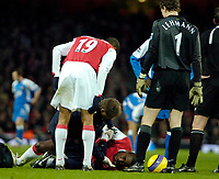 Photo: Ed Godden/Sportsbeat Images.<br /> Arsenal v Wigan Athletic. The Barclays Premiership. 11/02/2007. Arsenal's Johan Djourou lies injured.