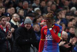 Crystal Palace's Wilfried Zaha reacts after missing a goal opportunity, during the Premier League match at Selhurst Park, south east London.
