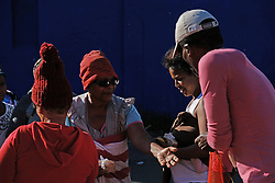 JOHANNESBURG, SOUTH AFRICA - APRIL 12: Homeless, unemployed and families living below the bread line, gather in Fietas to meet Shareef and his team who handed out a total of 300 food parcels on April 12, 2020 in Johannesburg South Africa. Under pressure from a global pandemic. President Ramaphosa declared a 21 day national lockdown extended by another two weeks, mobilising goverment structures accross the nation to combat the rapidly spreading COVID-19 virus - the lockdown requires businesses to close and the public to stay at home during this period, unless part of approved essential services. (Photo by Dino Lloyd)