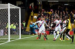 Watford goalkeeper Heurelho Gomes (left) saves a shot on goal