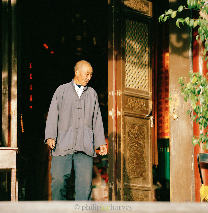 A temple caretaker in Dunhuang, a town along the old Silk Route in Jiuquan, Gansu province, China