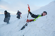 UNIS student Stephen Jennings digs himself out of the snow as classmates Emilia Piasecka (left) and Mei Gong pass on Rabotbreen, Svalbard.