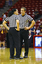 15 March 2012:  Referees Erika Herriman and Rod Creech during a first round WNIT basketball game between the Central Michigan Chippewas and the Illinois Sate Redbirds at Redbird Arena in Normal IL