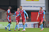 Abo Eisa (11) of Scunthorpe United celebrates with teammates during the Pre-Season Friendly match between Scunthorpe United and Doncaster Rovers at Glanford Park, Scunthorpe, England on 15 August 2020.