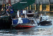 Forensic investigators and police officers stand on the wreckage of The Marchioness pleasure boat, on 20th August 1998 on the river Thames in London, England. The Marchioness disaster resulted in a fatal collision between two vessels on the River Thames in London on 20 August 1989, which resulted in the drowning of 51 people. The pleasure steamer Marchioness sank after being pushed under by the dredger Bowbelle, late at night close to Cannon Street Railway Bridge. (Photo by Richard Baker / In Pictures via Getty Images)
