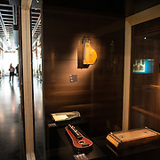 Stringed instruments on display on display at the Musical Instrument Museum in Brussels. The Musee des Instruments de Musique (Musical Instrument Museum) in Brussels contains exhibits containing more than 2000 musical instruments. Displays include historical, exotic, and traditional cultural instruments from around the world. Visitors to the museum are given handheld audio guides that play musical demonstrations of many of the instruments. The museum is housed in the distinctive Old England Building.