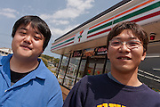 Nuclear refugees, Sato Takanobu and Nishiuchi Yoshihumi at a Seven-Eleven convenience store just outside the 20 kilometre exclusion zone around the damaged Fukushima Daichi nuclear power station near Minami Soma, Fukushima, Japan. Wednesday May 4th 2011