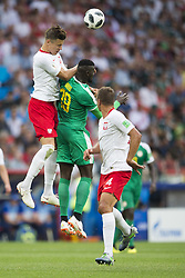 June 19, 2018 - Moscow - Jan Bednarek of Poland and Mbaye Niang of Senegal jump for the ball during the 2018 FIFA World Cup Group H match between Poland and Senegal at Spartak Stadium in Moscow, Russia on June 19, 2018  (Credit Image: © Andrew Surma/NurPhoto via ZUMA Press)