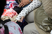 at a clothing and fabric flea market woman wearing a UV protection arm cover Japan