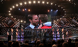 Gareth Southgate and Harry Kane are interviewed on stage by Gary Lineker during the BBC Sports Personality of the Year 2018 at Birmingham Genting Arena.