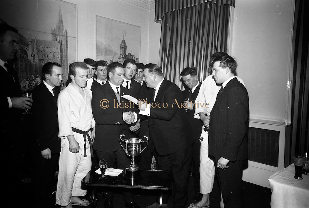 16/2/1966<br /> 2/16/1966<br /> 16 February 1966<br /> <br /> Mr. Peter Mcglynn District Manager, Beamish and Carling, handing over the Beamish and Carling Trophy and Prize money for the All Ireland Judo Championships to Mr. Charlie Hegarty, Chairman, Judo Assoc. of Ireland