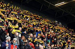 Watford fans hold up scarves in the stands