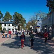 Tourists walking in Jomas Iela street, Jurmala, Latvia