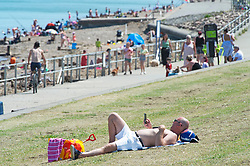 ©Licensed to London News Pictures 20/05/2020  <br /> Minster on sea, UK. A man sunbathing. People enjoying their lockdown freedom with a day by the sea at Minster-on-sea on the Isle of Sheppey in Kent. Today is expected to be the hottest day of the year with temperatures in the South East of the UK to hit around 29C. Photo credit:Grant Falvey/LNP