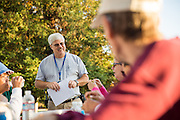 Mike Berryhill shares emergency safety information during National Night Out at Reuther Park in Milpitas, California, on August 4, 2016. (Stan Olszewski/SOSKIphoto)
