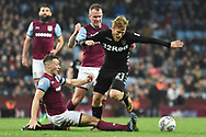 Leeds United midfielder Samu Saiz (21) is tackled by Aston Villa defender James Chester (5) during the EFL Sky Bet Championship match between Aston Villa and Leeds United at Villa Park, Birmingham, England on 13 April 2018. Picture by Alan Franklin.