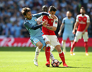 Arsenal's Granit Xhaka tussles with Manchester City's David Silva during the FA Cup Semi Final match at Wembley Stadium, London. Picture date: April 23rd, 2017. Pic credit should read: David Klein/Sportimage