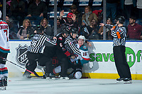 KELOWNA, CANADA - MARCH 14: Linesmen Cody Wanner and Dustin Minty try to stop a fight between Austin Crossley #6 of the Prince George Cougars and Kole Lind #16 of the Kelowna Rockets during third period on March 14, 2018 at Prospera Place in Kelowna, British Columbia, Canada.  (Photo by Marissa Baecker/Shoot the Breeze)  *** Local Caption ***