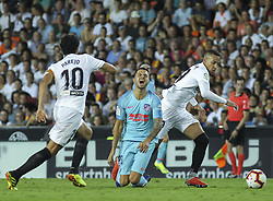 August 20, 2018 - Parejo and Rodrigo of Valencia and Vitolo of Atletico de Madrid in action during the spanish league, La Liga, football match between ValenciaCF and Atletico de Madrid on August 20, 2018 at Mestalla stadium in Valencia, Spain. (Credit Image: © AFP7 via ZUMA Wire)
