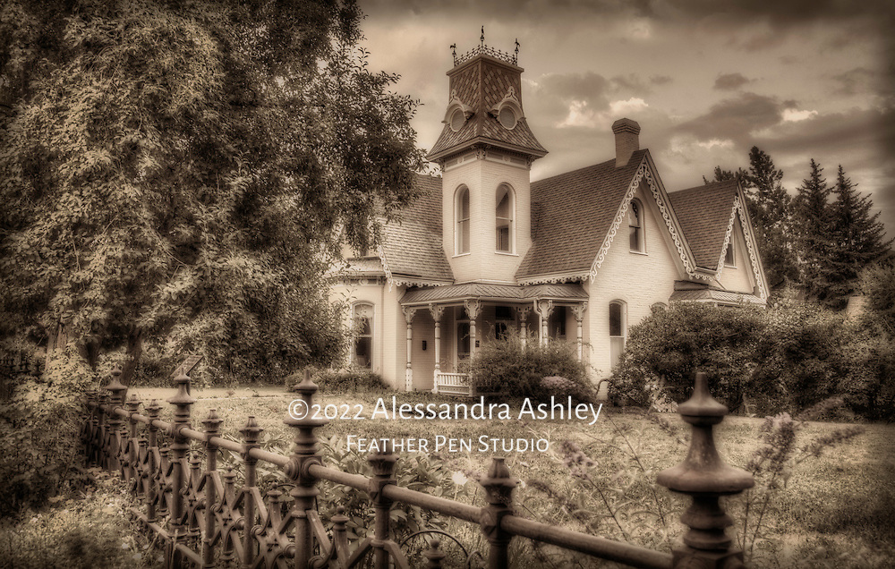 Historical Victorian home surrounded by summer bloom in downtown Boulder, CO.  High dynamic range image rendered in antique coffee tones.