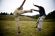 Pretend fighting (goofing off) at a high altitude mountain lake in Taiwan.