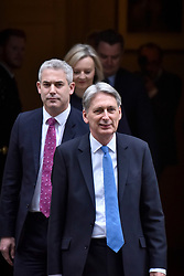 © Licensed to London News Pictures. 22/11/2017. London, UK. Chancellor of the Exchequer Philip Hammond, accompanied by his staff, departs Number 11 Downing Street to deliver his Autumn Budget to Parliament.  Photo credit: Stephen Chung/LNP