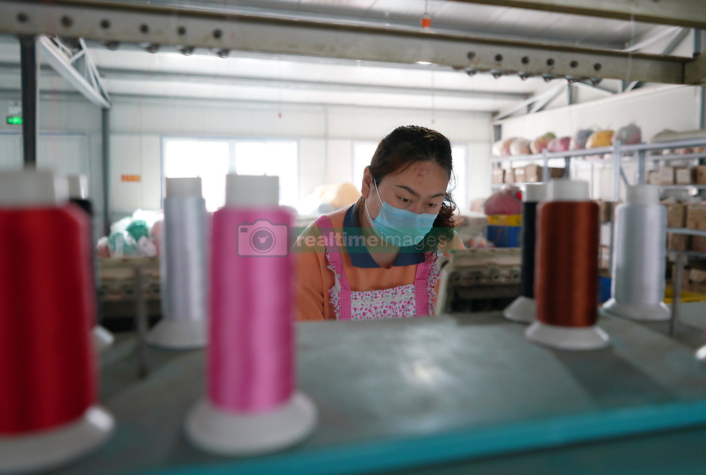 SHIJIAZHUANG, April 18, 2020  A woman works at a poverty alleviation workshop in Neiqiu County, north China's Hebei Province, April 18, 2020. In recent days, Neiqiu County has been actively helping local poverty alleviation workshops, which provide jobs for poverty-stricken residents in the county, resume production in an orderly manner to ensure stable income of villagers amid epidemic prevention efforts. (Credit Image: © Zhu Xudong/Xinhua via ZUMA Wire)