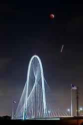 Total lunar eclipse and Margaret Hunt Hill Bridge, Dallas, Texas, USA