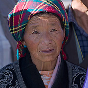 Tibetan people in the city square outside the Potala Palace in Lhasa. Lhasa is the capital city in Tibet. Asia.