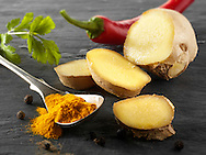 Fresh ginger root, red chili & ground turmeric. Indian spices