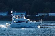 USA, Oregon, Portland, cabin cruiser on the Willamette River.
