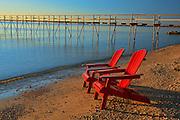 Muskoka chairs and pier on Lake Winnipeg<br />Matlock<br />Manitoba<br />Canada