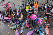 After the disruption to schools and exams during the Coronavirus pandemic in England, their first full week for pupils to return to the classrooms is shown by a collection of scooters and bikes left outside a school in the City of London, on 7th September 2020, in London, England.