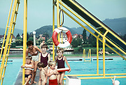 Children pose for a photo at a swimming pool in Germany, on 13th July 1970, in the Rhineland, Germany.