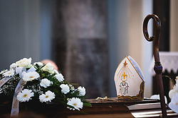 flowers hat and cane on his coffin during funeral of former bishop Jozef Smej, on November 24, 2020 in Bogojina, Slovenia. Photo by Blaž Weindorfer / Sportida