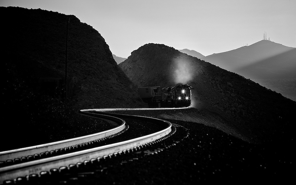 Climbing the grade out of Las Vegas towards the crest at Cima, CA, this westbound works hard through the curves at Sloan NV.