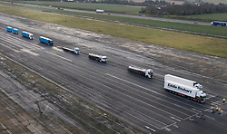 © Licensed to London News Pictures. 07/01/2019. Manston, UK. Trucks are seen parked on the runway of disused Manston airfield as they take part in a no-deal Brexit planning exercise. Up to 150 lorries are going to test traffic conditions on the 20 mile route between Manston and the Port of Dover.  Photo credit: Peter Macdiarmid/LNP