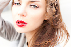 Close up of Young Woman Wearing Red Lipstick