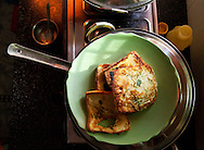 French toast is a popular breakfast food for the day school children at Astitva. Here, several slices await serving to the hungry children in a nearby room. Astitva, a non-governmental organization (NG)) in Debradun, India, helps battered women become more economically independent, such as starting small businesses. It also provides the women with family services so they have time to pursue their business interests. Dehradun is a city of 575,000 about six hours north of New Delhi by train. Nestled next to the Himalayan foothills, it's a little off the path for most tourists. Astitva is located in a neighborhood where poor and upper class people live within close proximity.