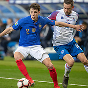 PARIS, FRANCE - March 25:  Benjamin Pavard #2 of France challenged by Gylfi Por Sigurdsson #10 of Iceland during the France V Iceland, 2020 European Championship Qualifying, Group Stage at  Stade de France on March 25th 2019 in Paris, France (Photo by Tim Clayton/Corbis via Getty Images)