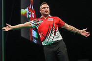 Gerwyn Price hits a double and wins a leg and celebrates during the Unibet Premier League darts at Motorpoint Arena, Cardiff, Wales on 20 February 2020.