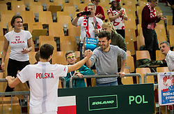 Hubert Hurkacz and supporters of Poland celebrate after winning during the Day 2 of Davis Cup 2018 Europe/Africa zone Group II between Slovenia and Poland, on February 4, 2018 in Arena Lukna, Maribor, Slovenia. Photo by Vid Ponikvar / Sportida