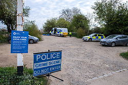 © Licensed to London News Pictures. 27/04/2021. Aylesbury, UK. Police at the scene following an assault near Bridge 14 on the Grand Union Canal near Broughton in Aylesbury at about 12.20pm on Monday 26/04)/2021. Police officers found a man with serious injuries and despite the efforts of emergency services the man died at the scene. Photo credit: Peter Manning/LNP