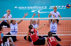 01-09-2012 ZITVOLLEYBAL: PARALYMPISCHE SPELEN 2012 USA - SLOVENIE: LONDEN.In ExCel South Arena wint USA van Slovenie / (L-R) Anita GOLTNIK URNAUT,  Jasmina Zbil, Sasa KOTNIK.©2012-FotoHoogendoorn.nl.