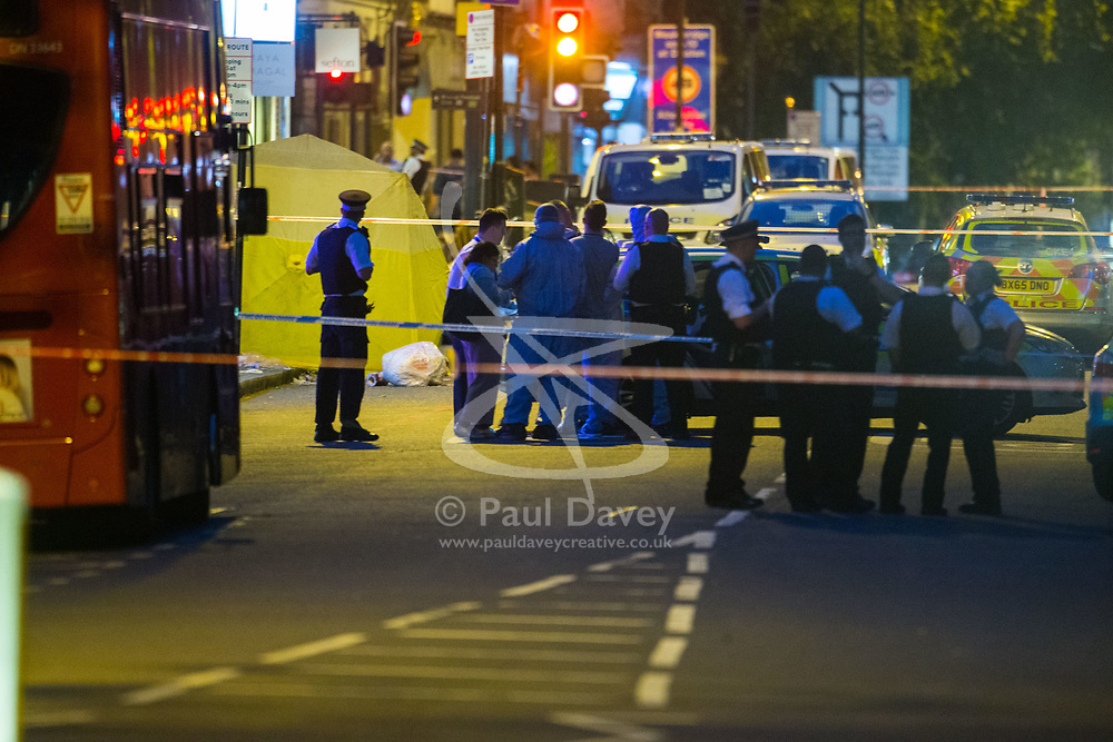 Police officers and forensics investigators at the scene following a fatal stabbing of a man in broad daylight at around 6.30pm on Upper Street in Islington, North London. London, May 21 2018.