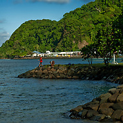 Locals enjoy a dip in the scenic bay in Pagp Pago's pretected harbor, Tutuila, American Samoa.