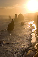 Twelve Apostles in hazy sunset, Western Victorian Coast, Australia.<br /> <br /> Larger JPEG + TIFF images available by contacting use through our contact page at :..www.photography4business.com